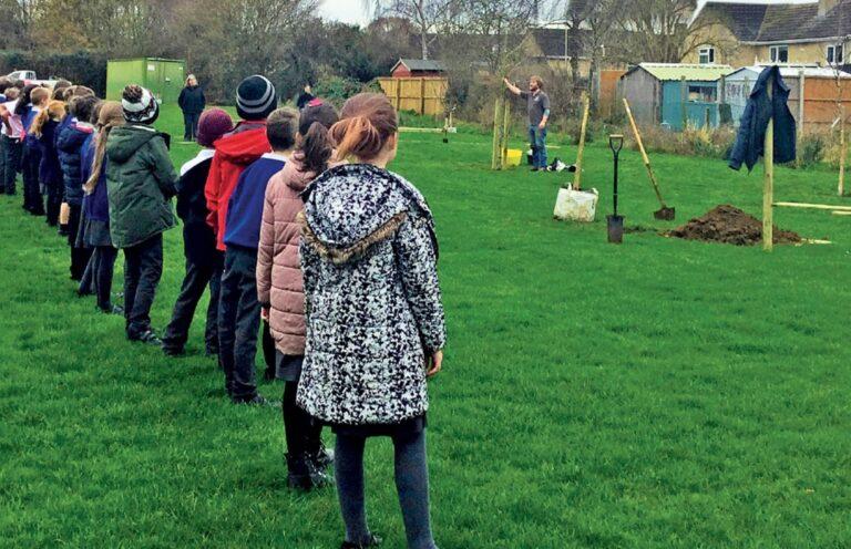 Tree planting marking the Association' first school membership
